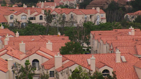 Identical stucco homes occupy a large neighborhood Stock Video Footage