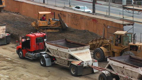 Tractors move dirt at a work site Stock Video Footage
