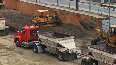 Tractors move dirt at a work site Footage