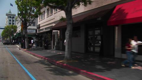 Tourists walk around Hollywood Footage