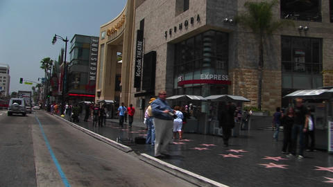 Tourists visit the Hollywood Walk of Fame Stock Video Footage