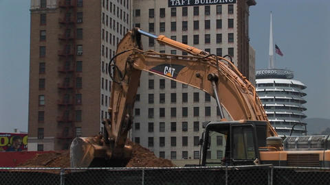 An excavator moves dirt Footage