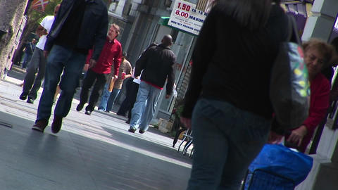 Pedestrians walk in a shopping district Stock Video Footage