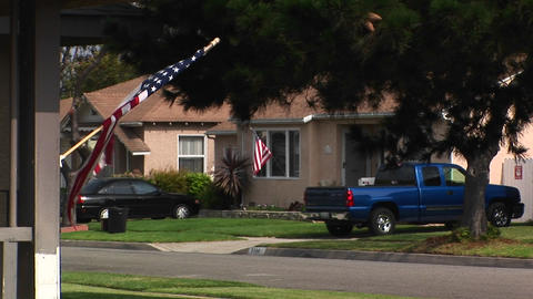 An American flag waves in a residential area Footage