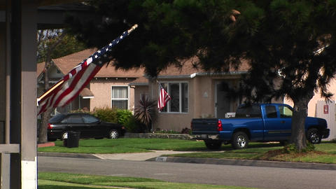 An American flag waves in a residential area Stock Video Footage