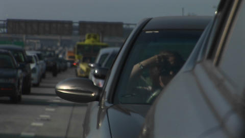 Cars in a traffic jam move slowly Stock Video Footage