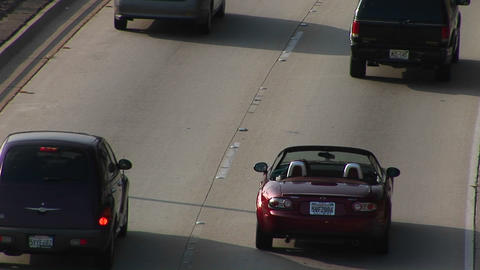 A sports car drives on the interstate Stock Video Footage
