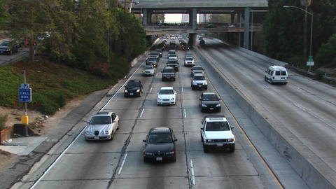 Traffic travels along a freeway Stock Video Footage