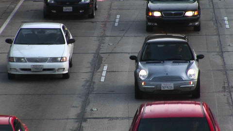 Traffic moves along a roadway Stock Video Footage