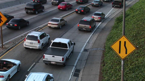 Vehicles slowly merge into traffic Stock Video Footage