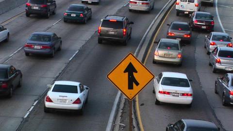Vehicles slowly merge into traffic Footage
