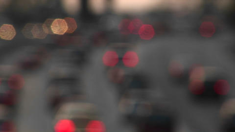 Vehicles' brake lights blink on and off on a busy roadway Stock Video Footage