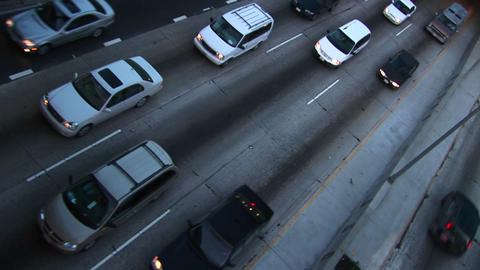 Traffic drives on a road Stock Video Footage