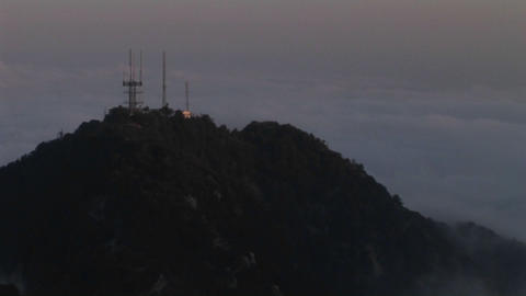 A time lapse of heavy cloud cover over antennas on a... Stock Video Footage