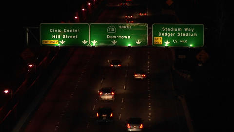A time lapse of vehicles driving on the freeway and under... Stock Video Footage