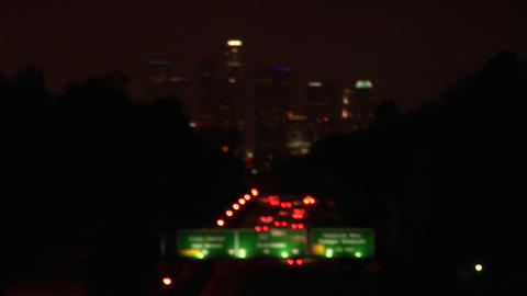 A rack-focus of vehicles driving on the freeway and into... Stock Video Footage
