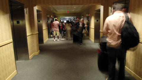 A time lapse of hotel patrons as they enter and exit... Stock Video Footage