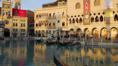 A sunset time lapse of gondolas moving through water Stock Video Footage