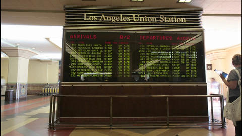 A time lapse of passengers looking at train arrivals and... Stock Video Footage