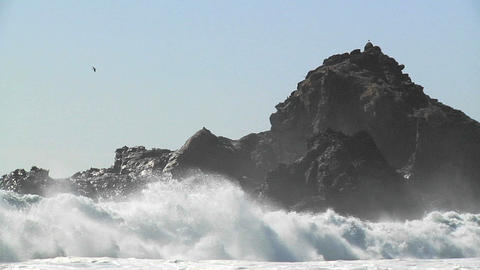 Waves Roll Into Shore On A Sunny Day Along California Coastline stock footage