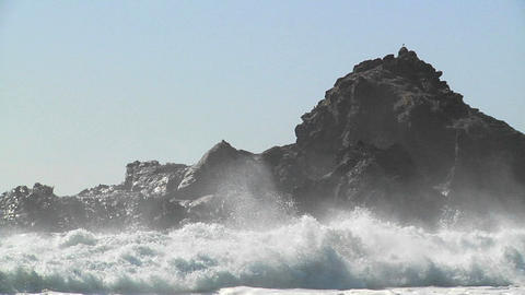 Waves roll into shore on a sunny day along California... Stock Video Footage