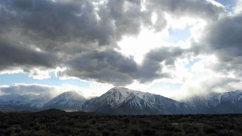 Time lapse shot of clouds moving over Sierra Nevada mountains in winter Footage