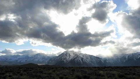 Time lapse shot of clouds moving over Sierra Nevada... Stock Video Footage