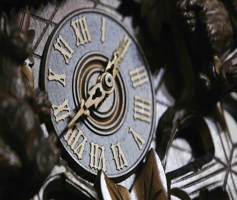 The hands of a cuckoo clock advance in this time lapse shot Stock Video Footage