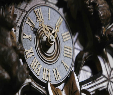 The hands of a cuckoo clock advance in this time lapse shot Footage