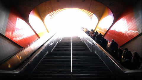 People ascend and descend via stairway and escalators at... Stock Video Footage