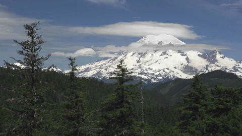 Time lapse of clouds passing a snow capped mountain... Stock Video Footage