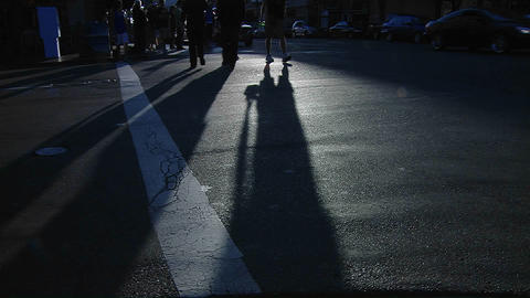 Pedestrians pass in a crosswalk on a busy city street as... Stock Video Footage