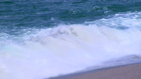 Ocean waves gently crest on the shore Footage