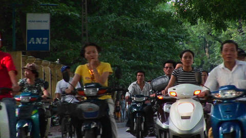 Motorbikes move along a road in ho Chi Minh City, Vietnam Stock Video Footage