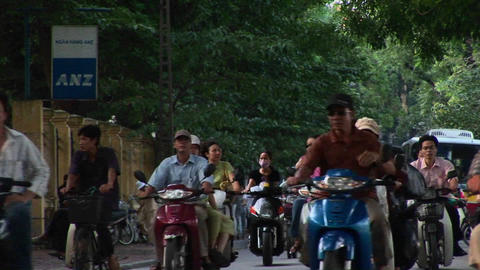 Motorbikes move along a road in ho Chi Minh City, Vietnam Footage