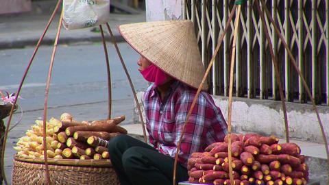 A woman sells her produce on the streets of Vietnam Stock Video Footage