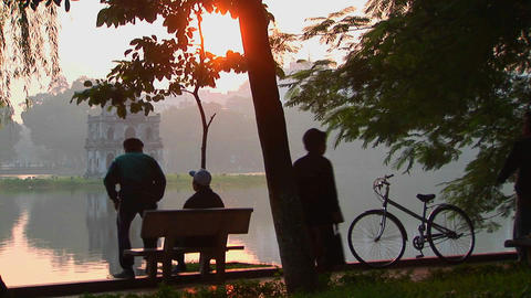 People sit in a park in Hanoi at sunset and admire the view Footage