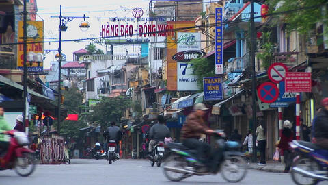 Pedestrians walk in downtown Hanoi Footage