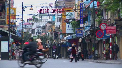 Pedestrians walk in downtown Hanoi Stock Video Footage
