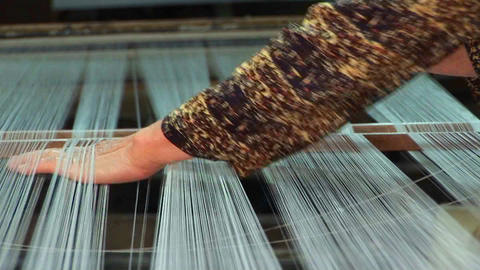 A woman works on a loom in a factory in Vietnam Stock Video Footage