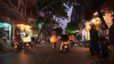A point of view shot from a motorbike heading through traffic in Vietnam Footage