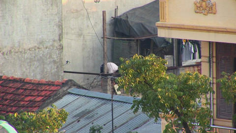 A man exercises on his rooftop in the early morning in... Stock Video Footage