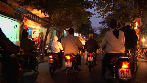 Point of view shot heading through a Vietnamese city by... Stock Video Footage