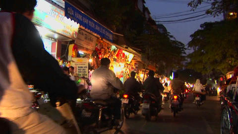 Point of view shot heading through a Vietnamese city by motorbike Footage