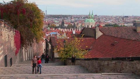People walk on the cobblestone streets of Prague, Czech... Stock Video Footage
