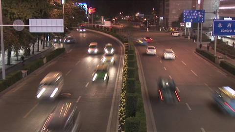Stop motion action of traffic passing on a Chinese road Footage