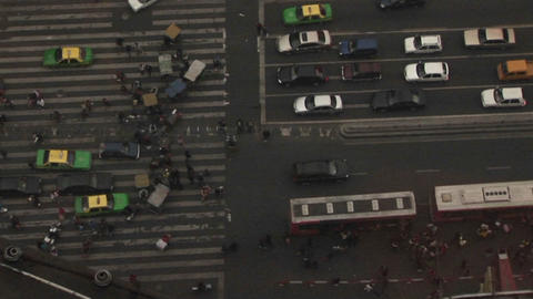 A view looking straight down at a street from atop a high building Footage