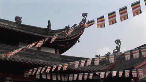 Flags hang from the eaves of a Chinese temple Stock Video Footage