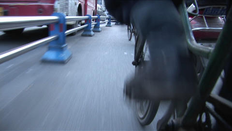 A POV shot of a man pedaling a rickshaw through the... Stock Video Footage