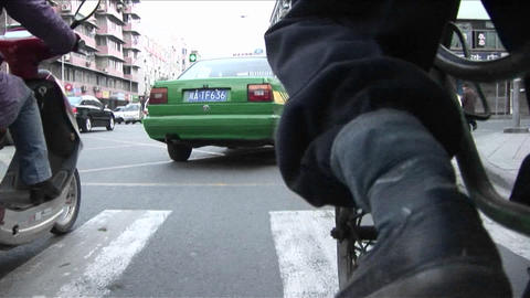 A POV shot of a man pedaling a rickshaw through the streets of Beijing China Footage